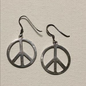 .925 Sterling silver peace sign earrings.